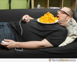 guy-laying-and-eating-chips-lazy